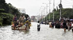Chennai: People rescue from their Watter lodged houses during heavy rains in Chennai on Wednesday. PTI Photo (PTI12_2_2015_000351A)